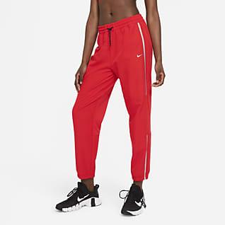 Nike Pro Byxor i vävt material för kvinnor