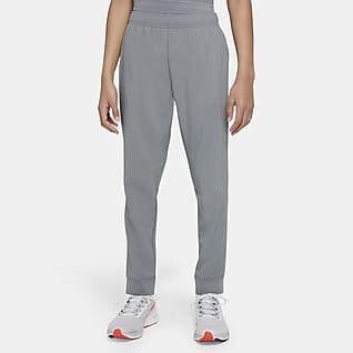 Nike Dri-FIT Spodnie treningowe z tkaniny dla dużych dzieci (chłopców)