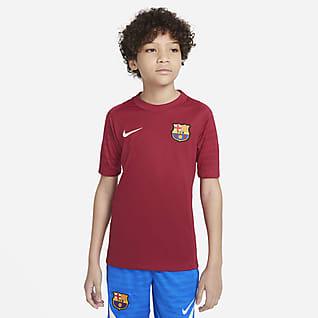 FC Barcelona Strike Nike Dri-FIT Kurzarm-Fußballoberteil für ältere Kinder
