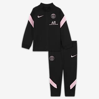 Paris Saint-Germain Strike Away Stickad fotbollstracksuit Nike Dri-FIT för baby/små barn