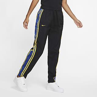 Warriors Courtside Pantalones de conjunto de entrenamiento Nike NBA para mujer