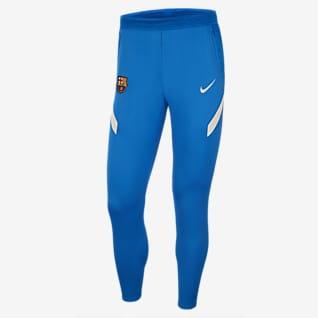 FC Barcelona Strike Męskie dzianinowe spodnie piłkarskie Nike Dri-FIT