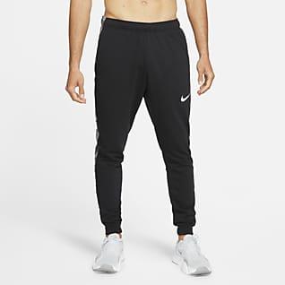 Nike Dri-FIT Trainingsbroek met toelopend design en camouflageprint voor heren