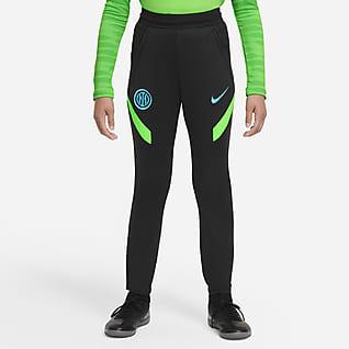 Inter Mediolan Strike Spodnie piłkarskie z dzianiny dla dużych dzieci Nike Dri-FIT