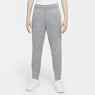 Nike Therma-FIT Pantalones de entrenamiento entallados con estampado para niños talla grande