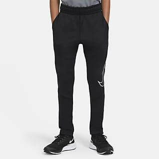 Nike Therma Spodnie treningowe o zwężanym kroju z nadrukiem dla dużych dzieci (chłopców)