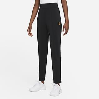 NikeCourt Dri-FIT Stickade tennisbyxor för kvinnor