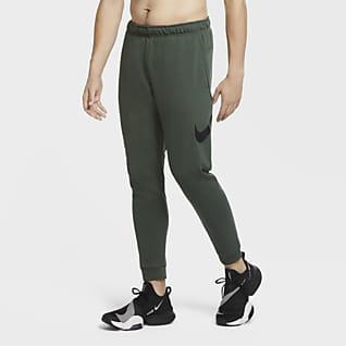 Nike Dri-FIT Träningsbyxor i avsmalnande modell för män
