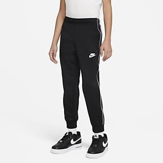 Nike Sportswear Běžecké kalhoty pro větší děti (chlapce)