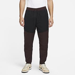 Nike Sportswear Tech Essentials Pánské kalhoty svodoodpudivou úpravou
