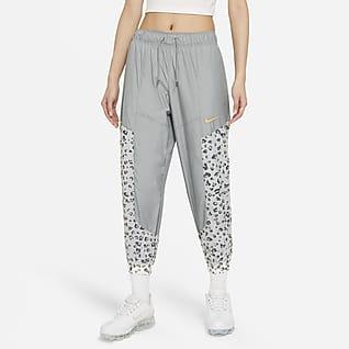 Nike Sportswear Pants de tejido Woven para mujer
