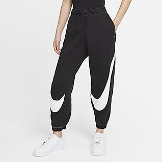 Nike Sportswear Swoosh กางเกงจ๊อกกิ้งผ้าฟลีซผู้หญิงใส่ง่าย