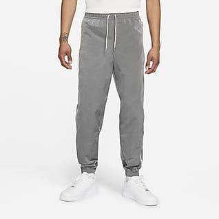 Nike Sportswear Style Essentials Pantalones de entrenamiento de tejido Woven sin forro para hombre