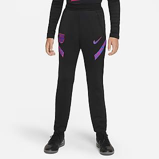 FC Barcelona Strike Spodnie piłkarskie dla dużych dzieci Nike Dri-FIT