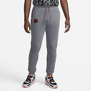 Paris Saint-Germain Męskie spodnie piłkarskie z dzianiny Nike Dri-FIT