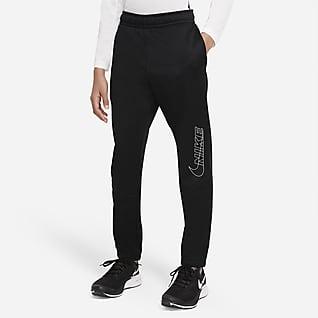 Nike Therma-FIT Spodnie treningowe o zwężanym kroju z nadrukiem dla dużych dzieci (chłopców)
