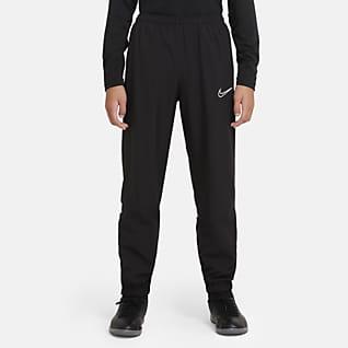 Nike Dri-FIT Academy Футбольные брюки из тканого материала для школьников