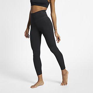 Kvinder Højtaljet Bukser og tights. Nike DK