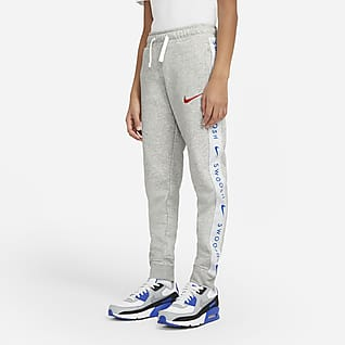 Nike Sportswear Swoosh Spodnie z dzianiny dla dużych dzieci (chłopców)