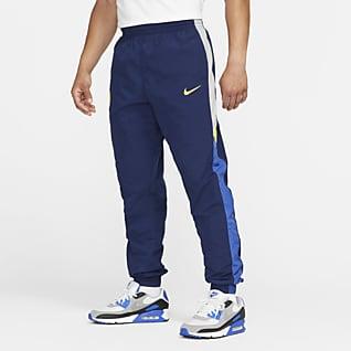 Chelsea FC Windrunner Męskie spodnie piłkarskie z tkaniny