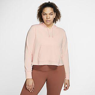 Nike Yoga เสื้อมีฮู้ดเอวลอยผู้หญิง (พลัสไซส์)