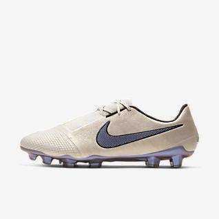 Chuteiras e sapatilhas de futebol. Nike PT