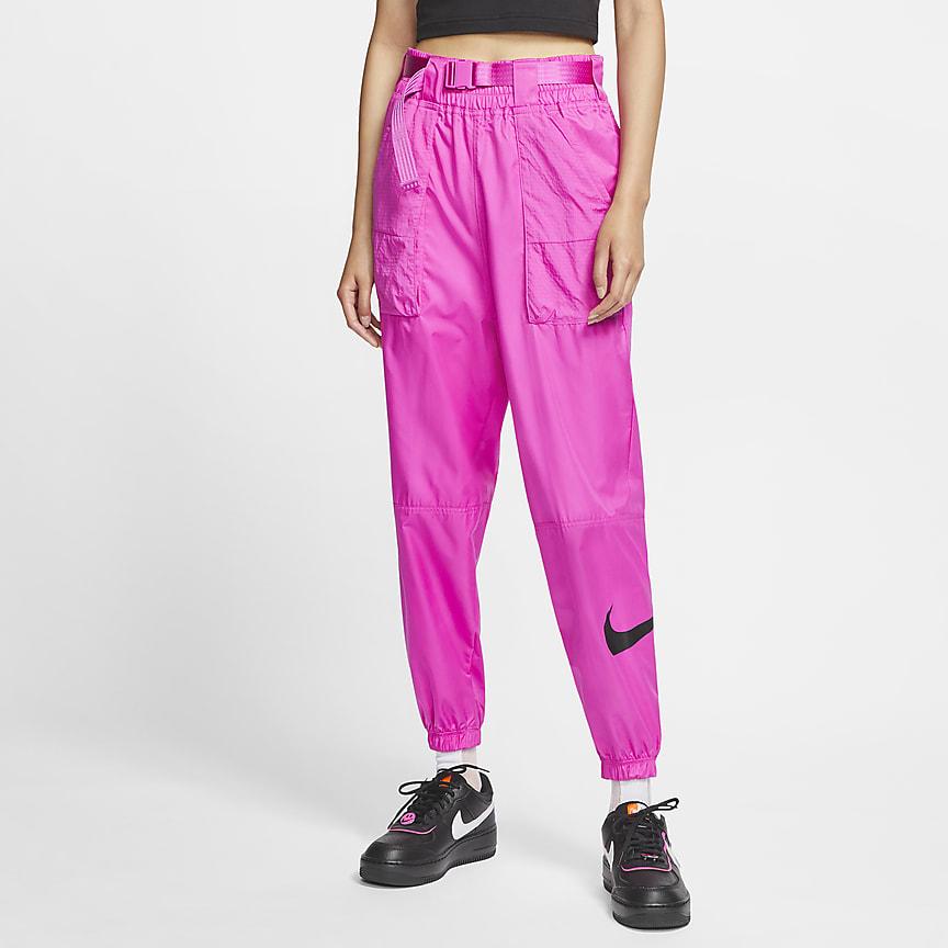 Damskie spodnie z tkaniny z logo Swoosh