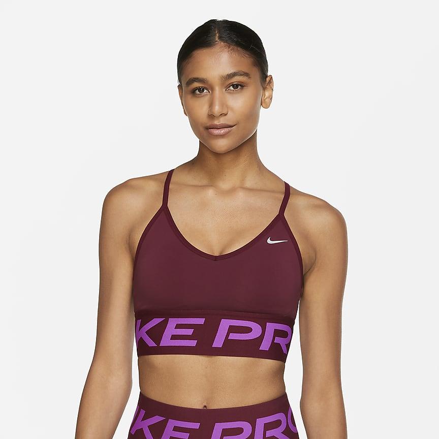 Sujetador deportivo de sujeción ligera con acolchado y escote alto - Mujer