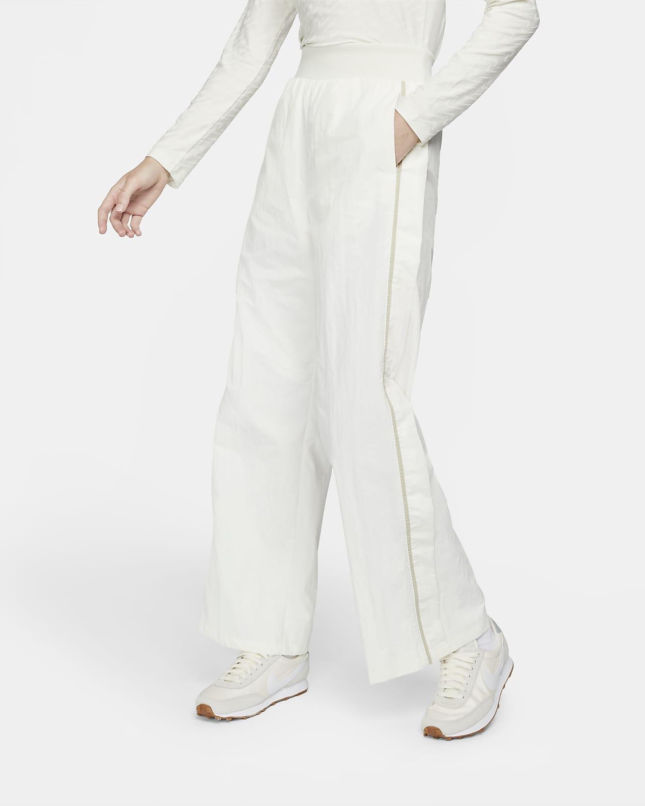 Damskie spodnie z tkaniny z szerokimi nogawkami Nike Sportswear Icon Clash