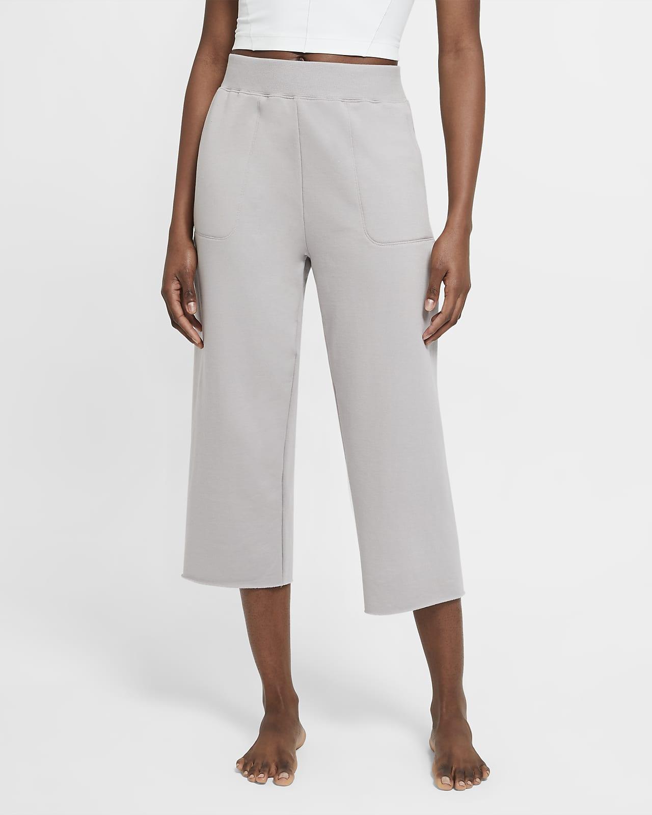 Pantalones pescadores de tejido Fleece para mujer Nike Yoga Luxe