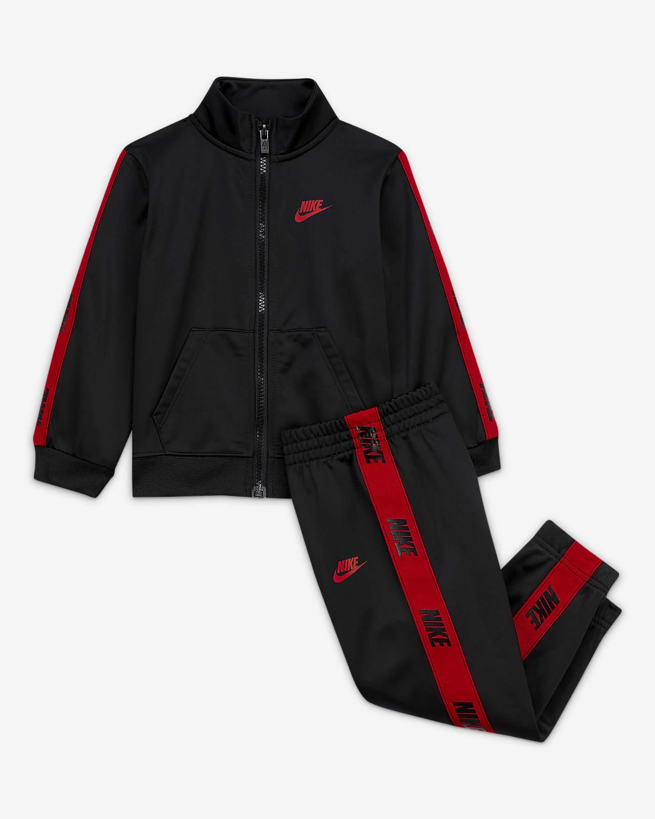 Zestaw kurtka i spodnie dla niemowląt (12–24 M) Nike. Nike PL