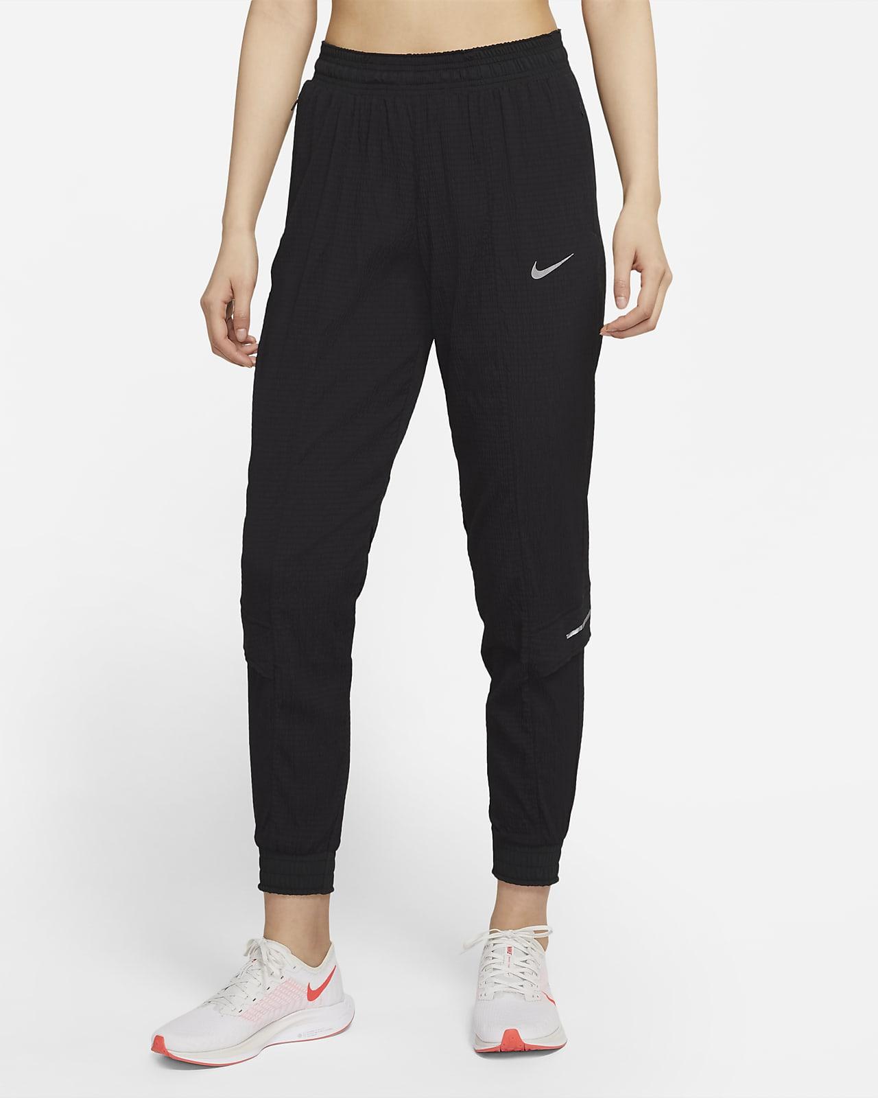 กางเกงวิ่งขายาวผู้หญิงพับเก็บได้ Nike Run Division Swift