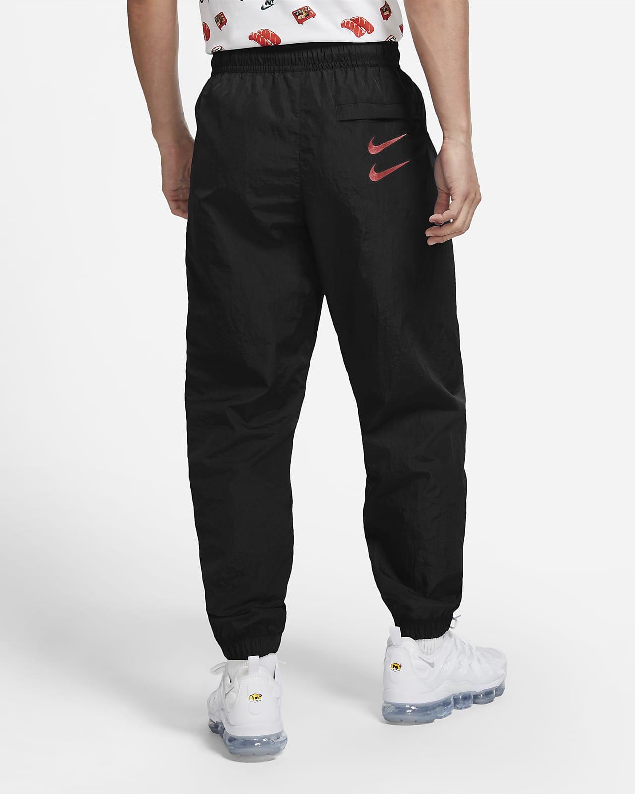 Apertura della confezione Ordine alfabetico essere colpito  Nike Sportswear Swoosh Men's Woven Trousers. Nike MY