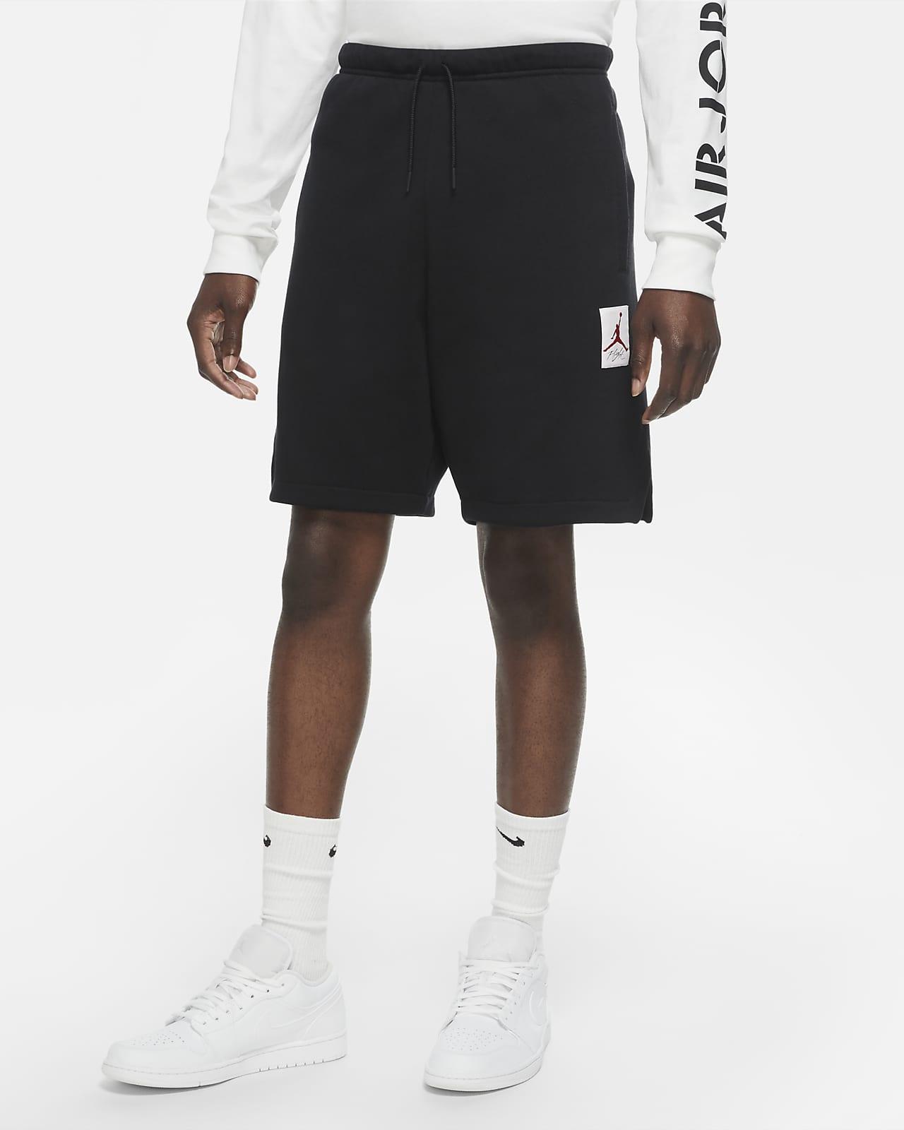 กางเกงขาสั้นผ้าฟลีซผู้ชายมีกราฟิก Jordan AJ4