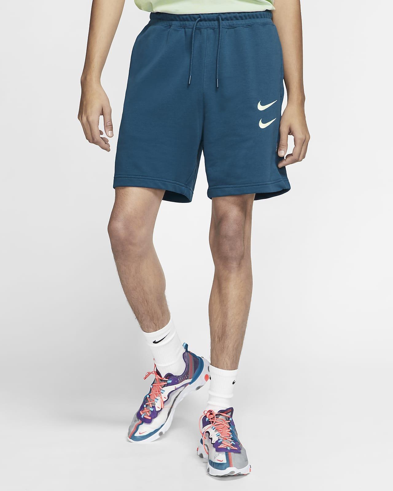 Birmania Goteo personal  Nike Sportswear Swoosh Pantalón corto de tejido French terry - Hombre. Nike  ES