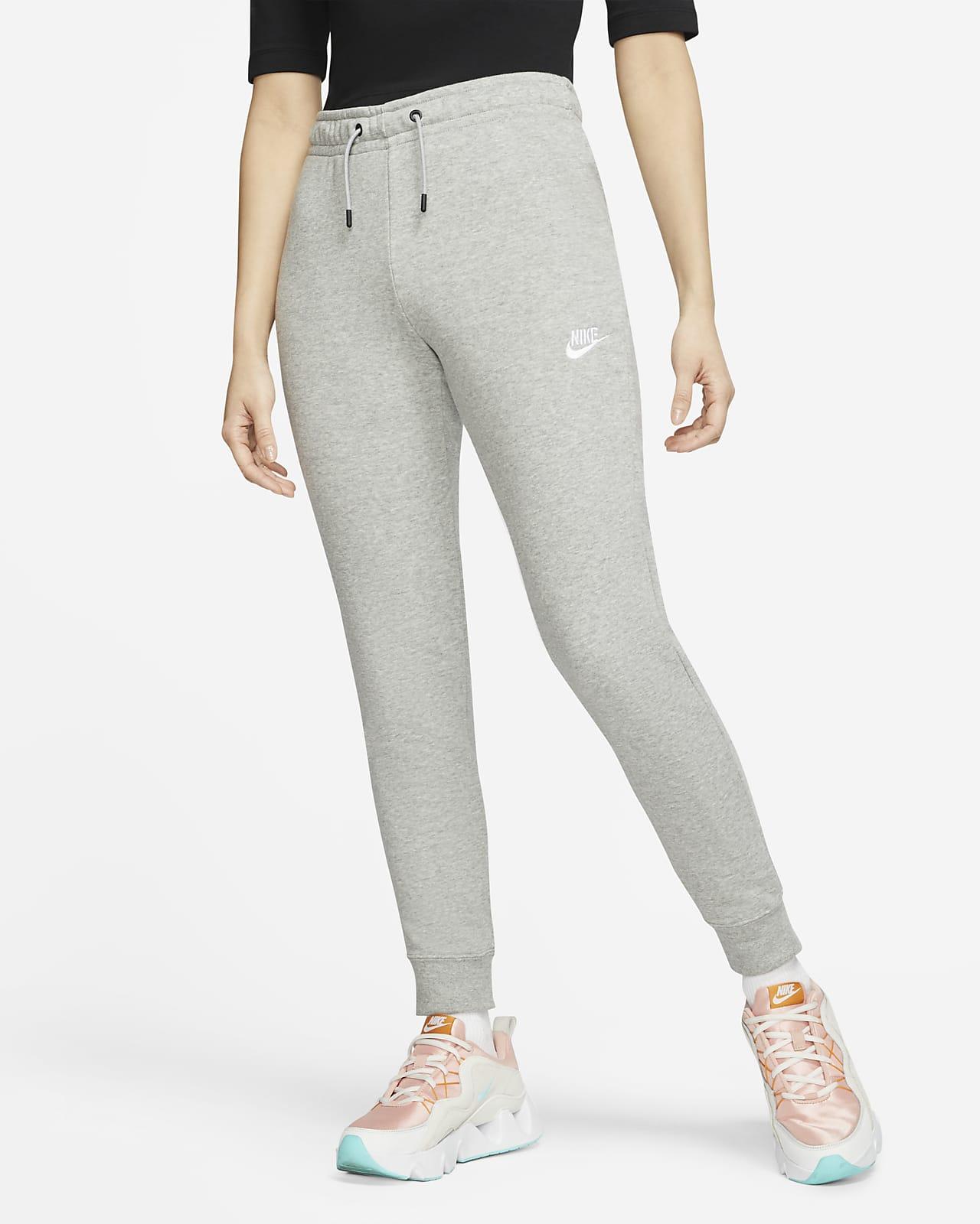 Pantalones de tejido Fleece de tiro medio para mujer Nike Sportswear Essential