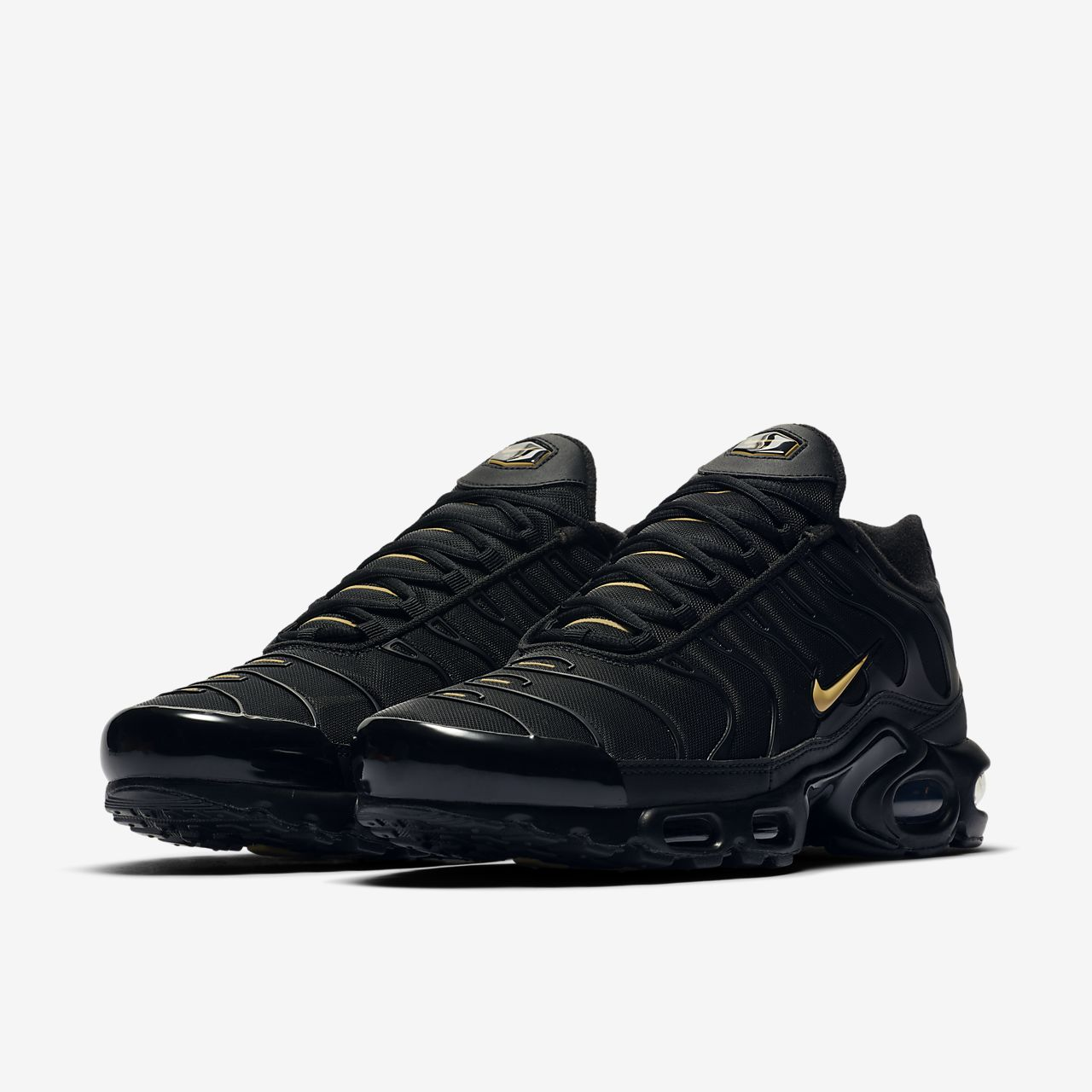 gold and white air max plus