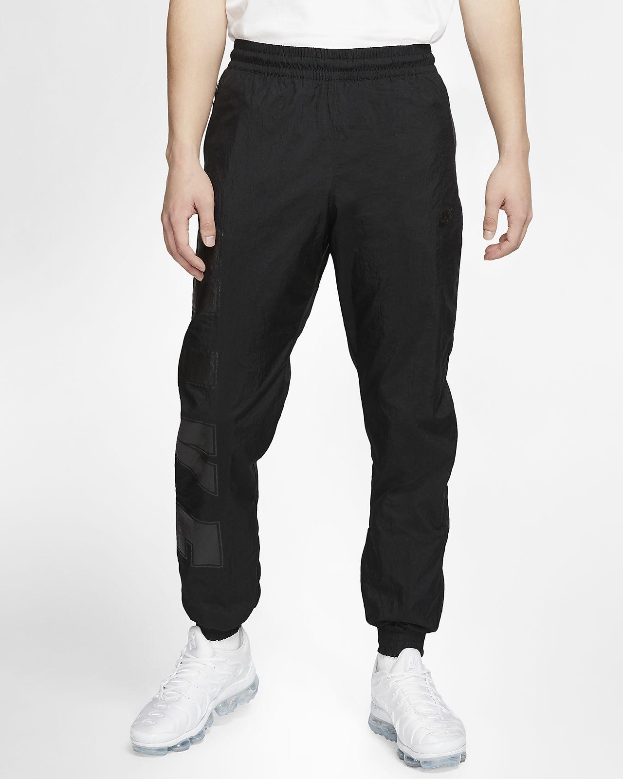 Nike CL Pantalons De Jogging Tissé: : Sports et