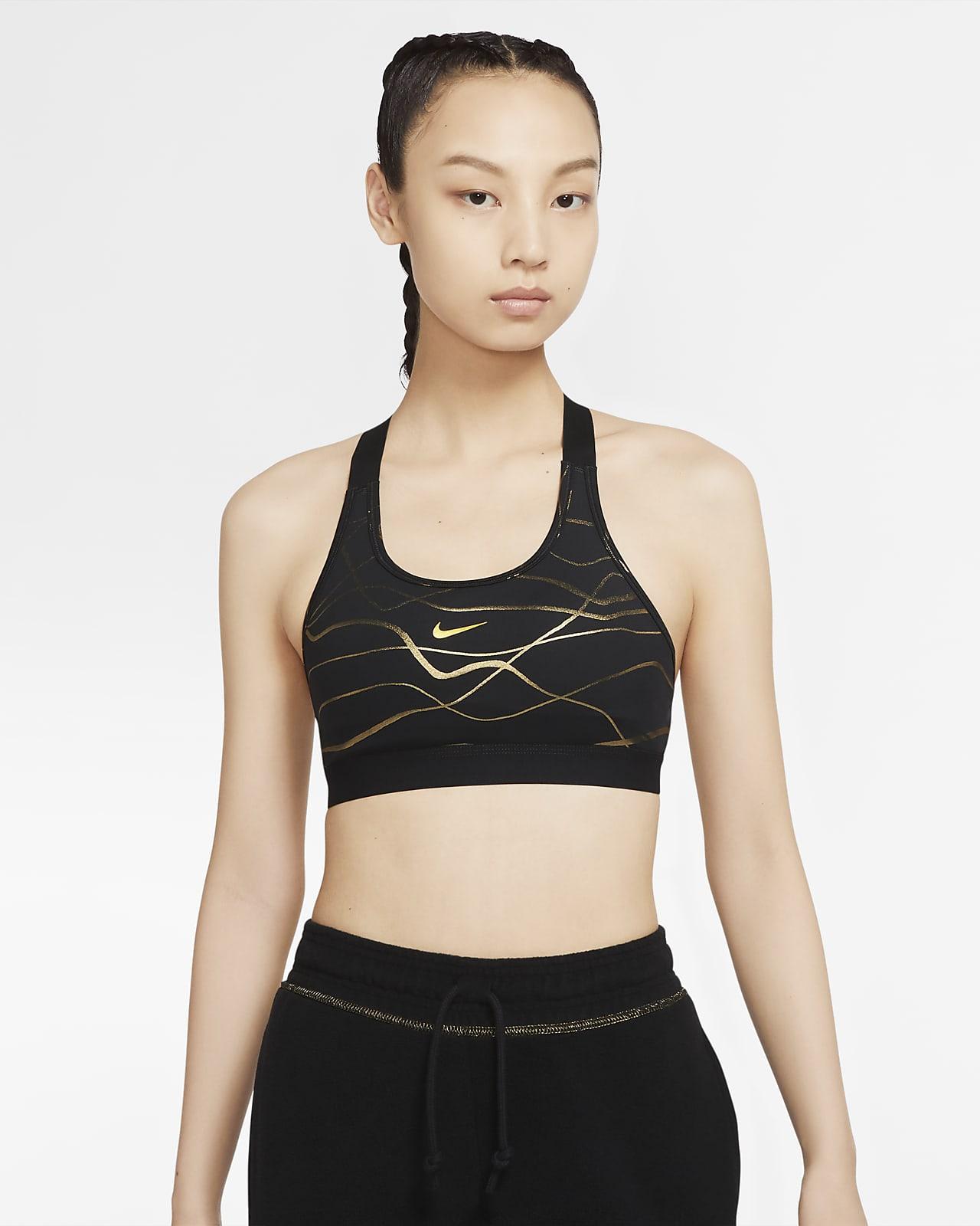 สปอร์ตบราผู้หญิงซัพพอร์ตระดับกลางพิมพ์ลาย Nike Swoosh Icon Clash