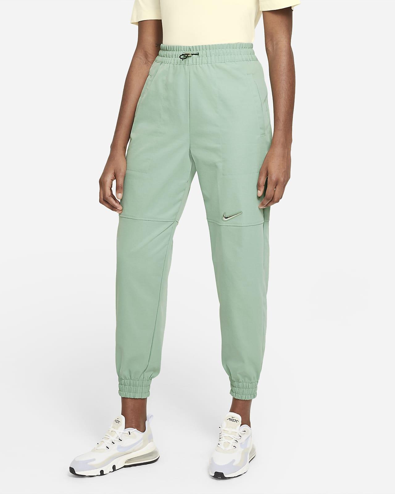 Calças de tecido Nike Sportswear Swoosh para mulher