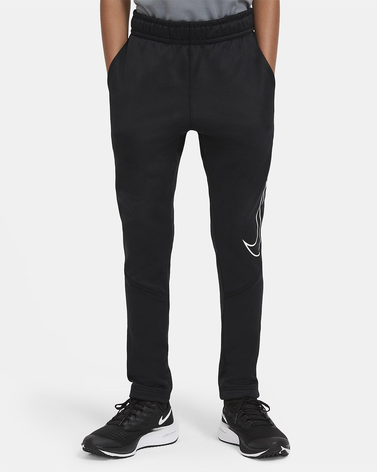 Spodnie treningowe o zwężanym kroju z nadrukiem dla dużych dzieci (chłopców) Nike Therma