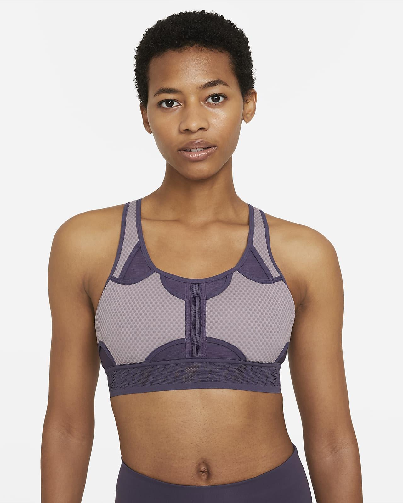 Damski stanik sportowy z wkładkami zapewniający średnie wsparcie Nike Swoosh UltraBreathe