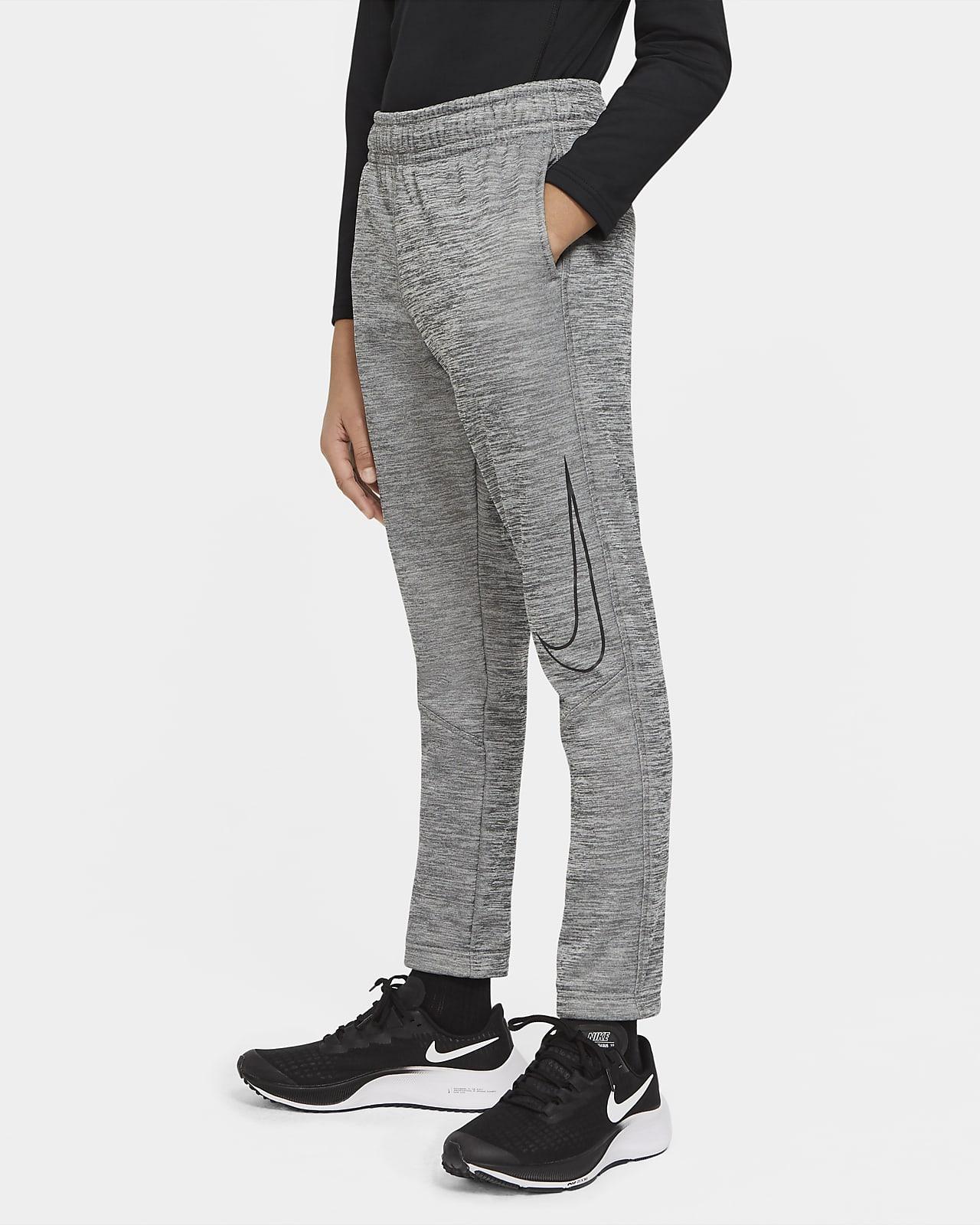 Pantalones de entrenamiento entallados con estampado para niño talla grande Nike Therma
