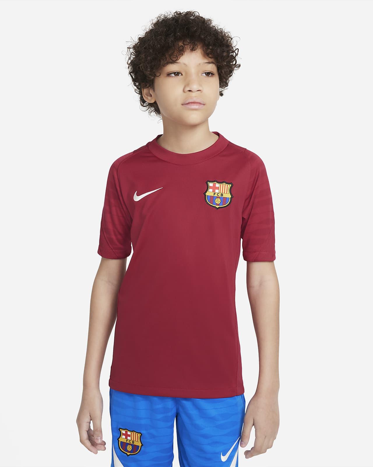 Haut de football à manches courtes Nike Dri-FIT FC Barcelona Strike pour Enfant plus âgé