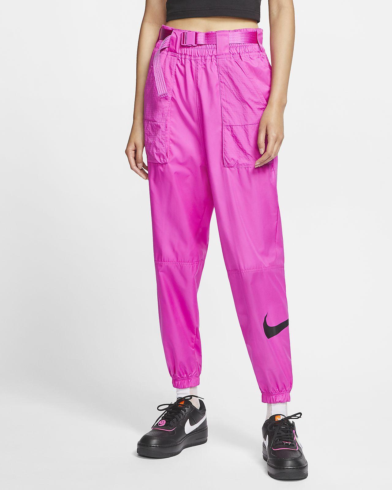 Damskie spodnie z tkaniny z logo Swoosh Nike Sportswear