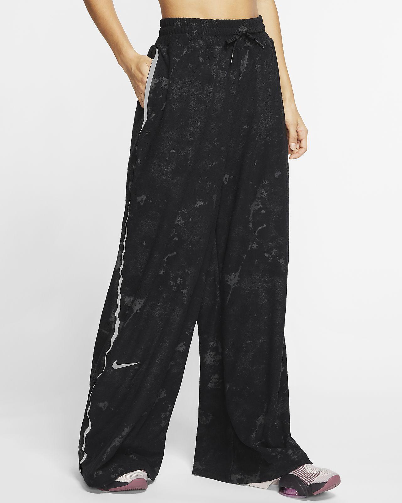 Nike City Ready Pantalons de teixit Fleece d'entrenament - Dona