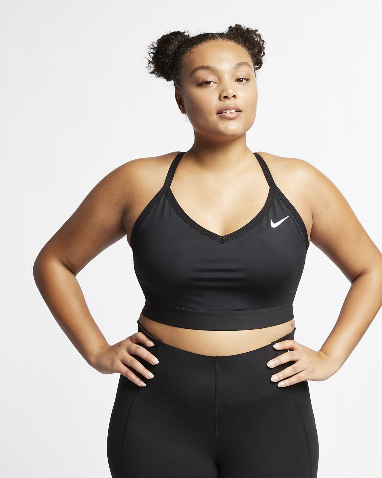 Damski stanik sportowy z wkładkami zapewniający lekkie wsparcie Nike Dri-FIT Indy (duże rozmiary)