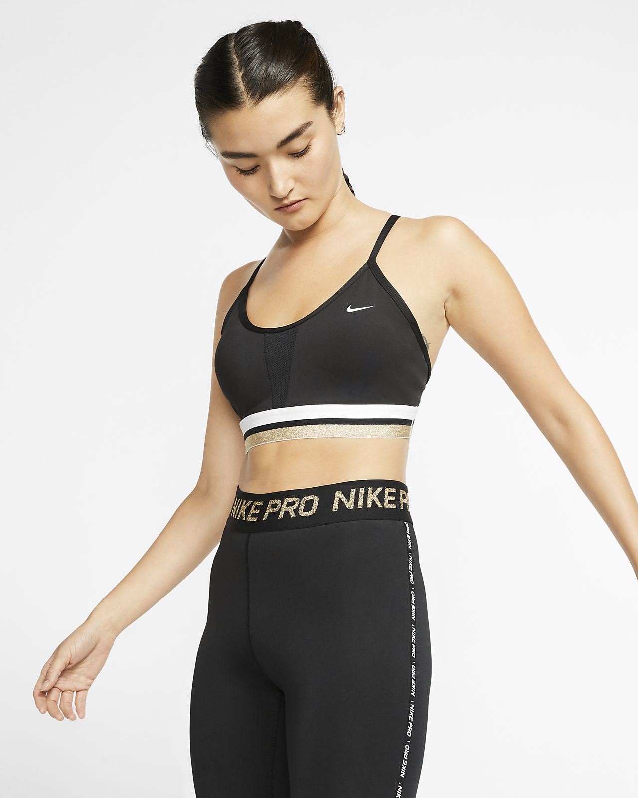 Sujetador deportivo de sujeción ligera para mujer Nike Indy Icon Clash