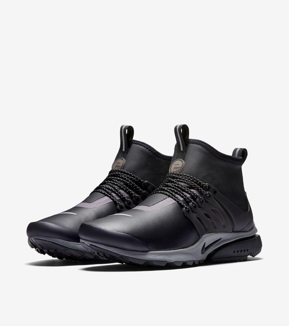 Women's Nike Air Presto Mid Utility Sneakerboot 'Black & Reflect Silver'. Release Date